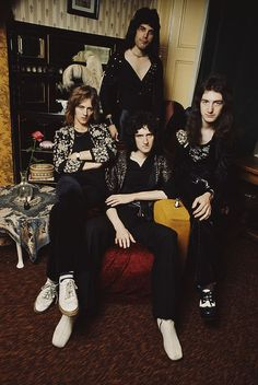 LONDON - 1st JANUARY: English rock group Queen posed  in lead singer Freddie Mercury's flat, Holland Road, West Kensington, London in early 1974. Left to right: Roger Taylor, Freddie Mercury (1946-1991), Brian May (bottom) and John Deacon. (Photo by Mark and Colleen Hayward/Redferns) Sayings, Costume, Champion, Entertainment, Celebrities, Guy Celebrities, Fancy Dress, Lyrics, Skirt Suit