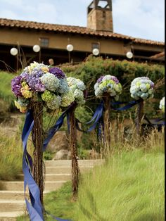 This is certainly for our more country brides but the idea of marking the way to the ceremony is wonderful and these ribbons blowing in the breeze would be a wonderful sight. Martha.