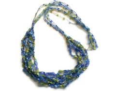 Crocheted Ribbon Necklace, Ladder Yarn Necklace, handmade ribbon necklace, trellis yarn necklace. $10.45, via Etsy.