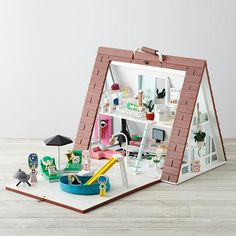 Shop A-Frame Dollhouse Deluxe Set.  Bright, modern and filled with style, this A-Frame Dollhouse Deluxe kit has it all.  The dollhouse includes plenty of rooms for your kids to play make-believe.