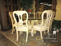 """Gorgeous Robb & Stucky glass top table on an ornate pedestal base in a light finish with six chairs. The chairs have cream upholstered seats. 60""""round. Great set for a formal dining room. Was $4,593 new!"""