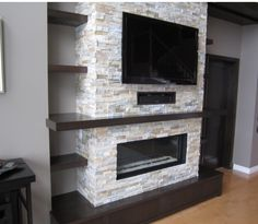Ideas for contemporary fireplace with built-ins and TV nook. Love the light stacked stone fireplace with the dark finish of the built-ins. Fireplace Tv Wall, Linear Fireplace, Basement Fireplace, Family Room Fireplace, Fireplace Built Ins, Fireplace Remodel, Fireplace Design, Fireplace Stone, Fireplace Ideas