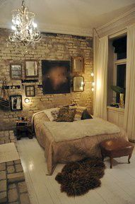 nyc bedroom..love the chandiler and brick wall