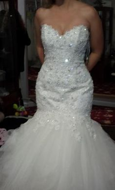 Maggie Sottero Sahara 8: buy this dress for a fraction of the salon price on PreOwnedWeddingDresses.com
