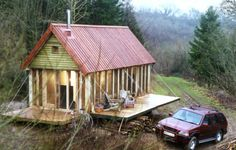 24' x 12' timber frame Foresters Cabin by Roderick James Architects; frame by Carpenter Oak; the decks fold up to secure the cabin when not in use