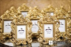Place cards using ornate gold frames with printed cards inside.