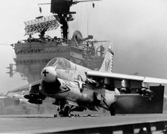 Loaded with bombs, an A-7A Corsair II of Attack Squadron (VA) 27 prepares to be catapulted off the flight deck of the aircraft carrier Constellation (CVA 64) steaming in the waters of the Tonkin Gulf...