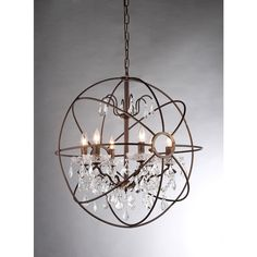 Insert a captivating focal point into your home with this unusual Edwards chandelier. Six lovely lights sit encased in a metal sphere, dripping with crystals that catch both the eye and the light.
