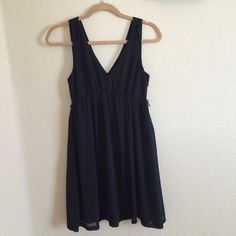 """American Eagle little black dress Black V neck and V back sleeveless dress from American Eagle Outfitters. Sturdy, comfortable material with sheer overlay. Comes to about the knees on me and I'm 5""""2. Great condition. Pretty, simple LBD. American Eagle Outfitters Dresses Mini"""