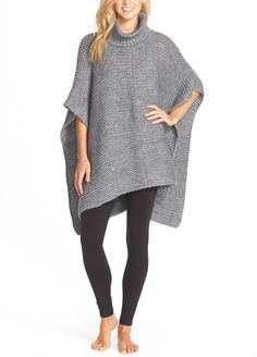 Embracing cool temps in this UGG Australia chunky, turtleneck-topped poncho thats so easy to layer.