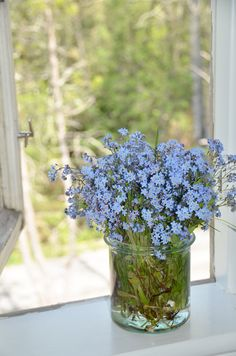 """Flower arrangement: 1/2 inside, 1/2 out -- Huset, Lunden, """"The house in the Grove"""""""