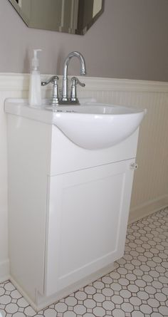 VERY affordable compact bathroom sink, double door cabinet for downstairs bath/laundry room.