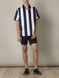 Navy and white stripe cotton short-sleeve shirt. Infuse your weekend wardrobe with a dose of Scandinavian cool with this Oahu style from Acne. With bold graphic stripes contrasted with a stark black collar, this directional piece is the perfect partner to tailored shorts and brogues.  Shown here with Acne short and Lanvin Derby shoes.