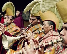 Gelug monks in Tibet play Gyalings during a ritual puja. Gyalings, similar to oboes, are traditional double reed instruments that are played by using circular breathing.