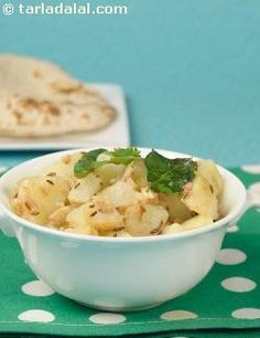 """A simple dish of potatoes tempered with green chillies and curry leaves and spiced up with crushed peanuts. This is also enjoyed during fasting days and is also called """"Puneri Aloo""""."""