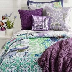 Purple Paradise. Transform your room into an exotic getaway with this girly and glamorous collection. Deep purple paired with eye-catching teal give this collection its tropical feel. The splashes of color and hints of Southern quilt make this duvet the perfect complement to bold, regal accents.*Some of the products included within this collection are pre-order items.