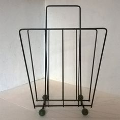 SOLD - Atomic magazine rack, mid century modern - black with green feet by BlindDogVintage on Etsy