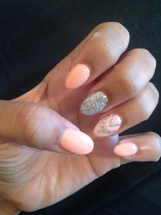 This is a very cute peach colour I honestly am wanting these nails so much! But that glittery silver tho :D