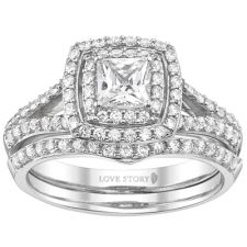 This stunning 14K white gold bridal set is the perfect way to symbolize your commitment to each other! The ring features a double halo with an elegant split band and is set with 3/4 carat t.w. of round diamonds H-I color and SI2 clarity. The engagement ring holds a princess cut cubic zirconia that can accommodate most diamond sizes.
