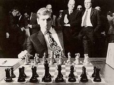 Bobby Fischer plays chess, old portly white men look on, 1972.