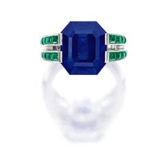 Fine Sapphire, Emerald and Diamond Ring, Cartier Centering on a step-cut sapphire weighing approximately 12.00 carats, flanked by calibré-cut emeralds together weighing approximately 1.60 carats, decorated by circular-cut diamonds, mounted in platinum