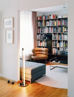 Design with Eileen Gray furniture.  Bibendum Chair - 1929 Tube Light - 1927 Day Bed - 1925