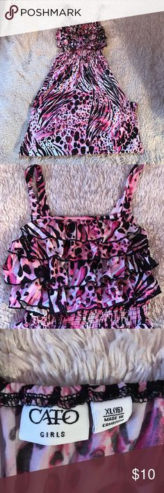 Girls maxi dress Girls size XL (16) maxi dress in excellent used condition. Beautiful pink, black, and white pattern. Does not have adjustable straps. Ruffle design on chest. Dress is longer that it appears in pictures, I had to fold it under on the bottom to photograph it Cato Dresses