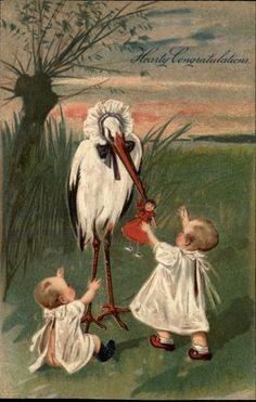vintage postcard stork doll