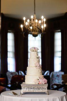 White wedding cake with fresh flowers | Douglas Levy Photogrpahy | Theknot.com