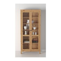 HEMNES Glass-door cabinet  - IKEA  $320.00 Solid wood has a natural feel. With a glass-door cabinet, you can show off as well as protect your glassware or your favorite collection.