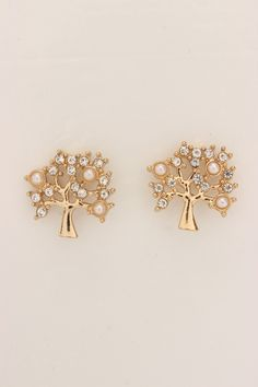 Trees Give your get-up a dose of instant glamour by adding these darling earrings into the mix. Boasting a shiny high polished metal, tree carved design, these rhinestone studded earrings are complete with post lock closures. Because a fab fashionista such as yourself, knows the importance of simple accessorizing!