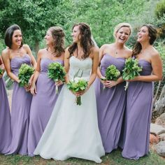 Long, lilac bridesmaid dresses | Andrew Jade Photography | Theknot.com