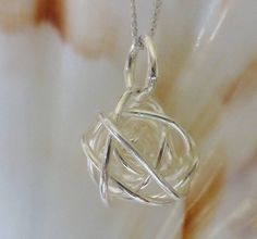 bound sphere silver pendant and chain by anne reeves jewellery | notonthehighstreet.com