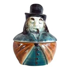 This charming antique porcelain dish is an Austrian tobacco jar or humidor from around The figural porcelain dish, popular around the turn of. Antique Cookie Jars, Disney Traditions, Long Brown Hair, Vintage Cookies, Warts, Jaba, Chinoiserie, Pottery Art, Figurative