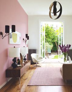 This calm Edwardian home in London is a masterclass in modern design. We love the pink walls, which combine with masculine furniture very successfully. Image: Livingetc