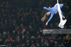 A woman performs prior to the Serie A match between AC Milan and ACF Fiorentina at Stadio Giuseppe Meazza on February 19, 2017 in Milan, Italy.