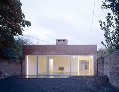 The concept of  the house was dictated by the site and brief requirements and the inevitable  choice of brick as the main building material; giving a materiali...