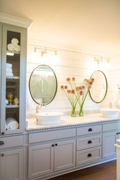 I like the shiplap behind the oval mirror. Oval mirror = possible thrift find? Love the gray paint color on the cabinetry.