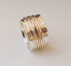 A personal favorite from my Etsy shop https://www.etsy.com/listing/93080486/sterling-and-gold-spinner-ring-fiddle