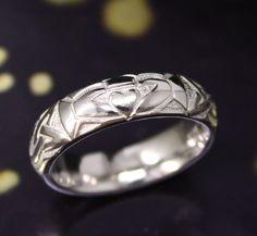 Irish Celtic wedding ring with claddagh design