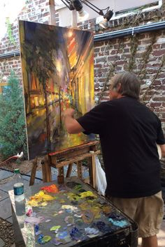 Ballard Designs Exclusive Artist Rick Reinert paints in his outdoor studio in Charleston, South Carolina. He even has a retractable roof so he can keep painting during those tropical rain storms!