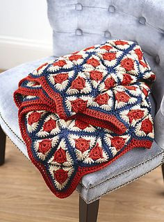 This project is a beautiful blanket with circular colors within squares. we get a large granny square where we form them up into this beautiful blanket. Crochet Afghans, Crochet Motifs, Crochet Squares, Crochet Blanket Patterns, Crochet Granny, Crochet Stitches, Knitting Patterns, Crochet Blankets, Crochet Triangle