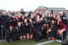 The Santa Clara women's soccer team celebrates after winning a share of the West Coast Conference title.