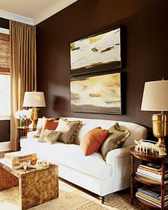 Bedroom Sitting area - chocolate walls, light white sofa, gold