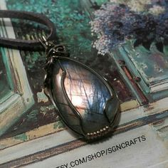 Rare Purple Lavender Labradorite Spectrolite wirewrapped in silver wire and dipped in patina for antique look.