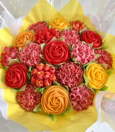 Big cupcake bouquet with Red, orange and yellow Roses Yellow Cupcakes, Flower Cupcakes, Cupcake Bouquets, Big Cupcake, Cupcake Cakes, Cupcake Ideas, Cupcakes Delivered, Cookie Bouquet, Beautiful Cupcakes