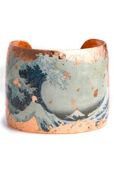 Brilliant copper leaf frames and splashes across a handcrafted cuff featuring an awe-inspiring image from a 19th-century Japanese painting