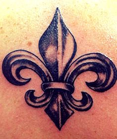 The Fleur De Lis represents royalty and victory in battle. Religious significance includes a representation of the Virgin Mary and, due to the three stylized petals, a reference to the trinity M Tattoos, Tattoo You, Body Art Tattoos, Tribal Tattoos, Tattoo Fleur, Flor Tattoo, Awareness Tattoo, French Tattoo, Geniale Tattoos