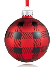 Perfectly plaid, this Holiday Lane Buffalo Check Ball ornament adds classic style to your tree decor.   Glass/metal cap   Wipe clean   Imported   Approximate dimensions: 8.3 cm   Attached grosgrain ri