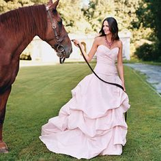 Pink Wedding Dresses This figure-friendly frock would be elegant in ivory, but Amalia Carrara made it a winner of a whimsical gown, awash in cotton-candy pink. $5,400, Amalia Carrara.